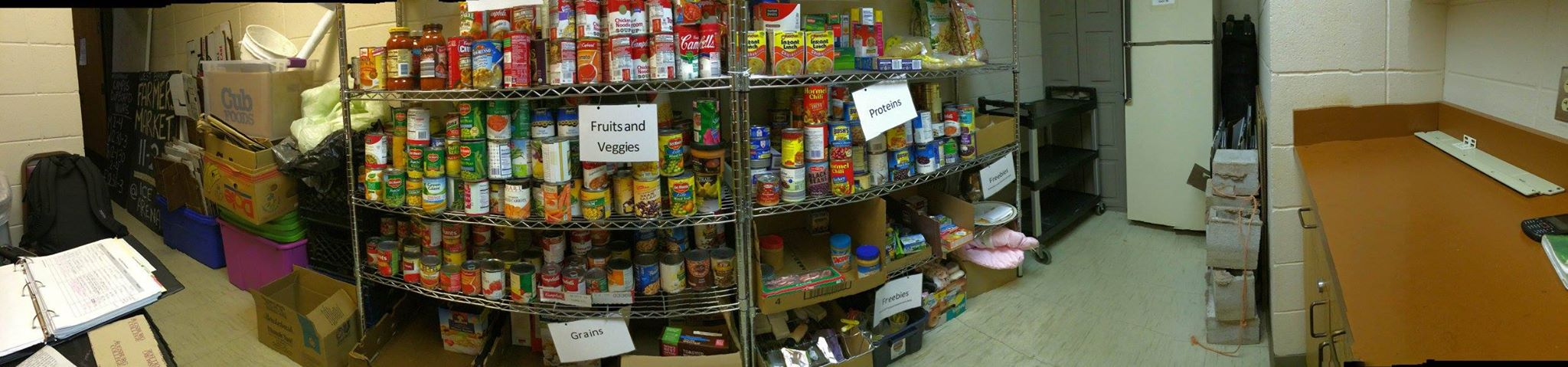 shelves with canned goods and label signs