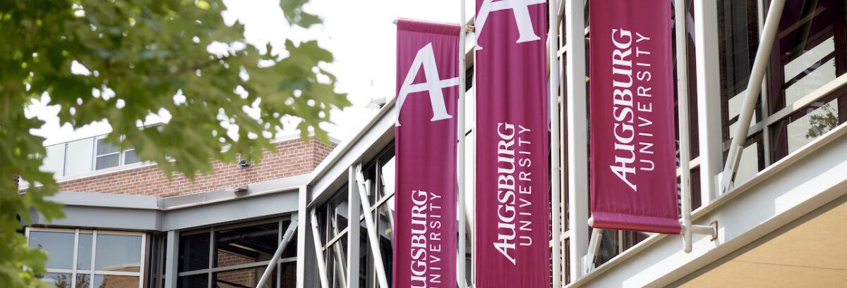 "Maroon ""Augsburg University"" banners outdoors"