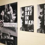One Day in May posters hanging on wall