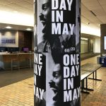 One Day in May posters wrapped around pole
