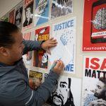 art project participant traces a poster