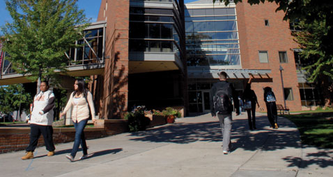 Students walking to and from Lindell Library on a sunny day.